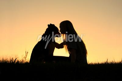 Canvas print German Shepherd Dog, silhouetted against the sunsetting sky