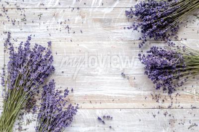 Wall mural Dry lavander design with bouquet on wooden background top view mockup