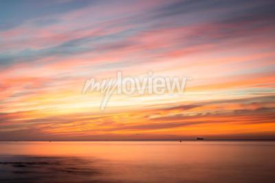 Sticker Fototapeta: Sunrise over a beach in Cornwall UK