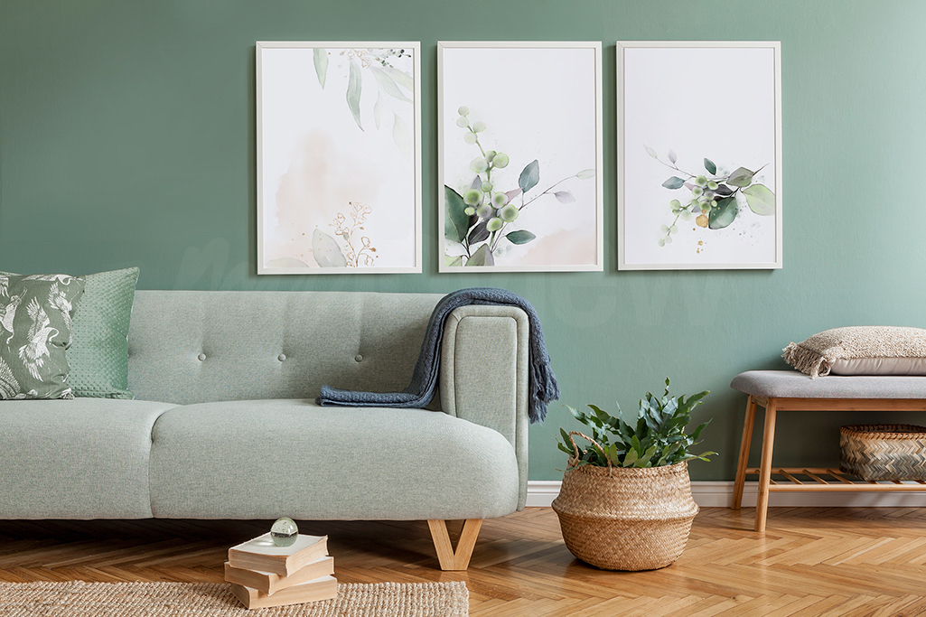 A minimalist triptych with a floral motif can serve as a contrast to dark furniture, which will make for a very interesting effect